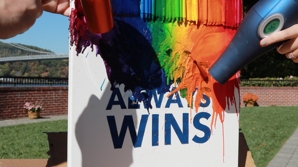 Melting crayons to make our Love Always Wins art piece