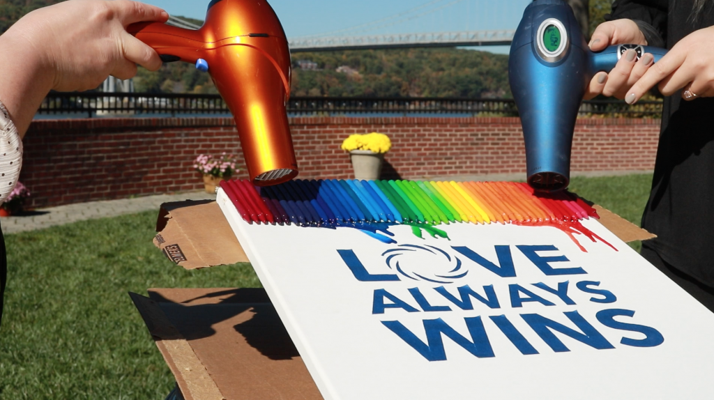 Melting Crayola crayons to make our #LOVEALWAYSWINS sign at The Grandview in Poughkeepsie NY overlooking the Hudson River in October